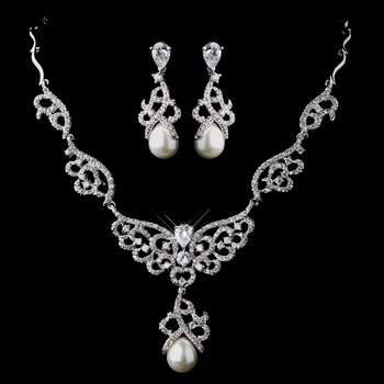 SilverStunning, silver plated waves lead down to intricate swirling patterns encrusted in diamonds.