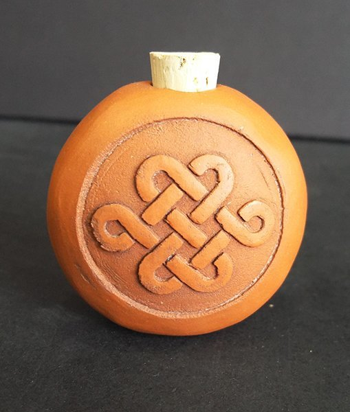 Terracotta bottle embossed with friendship knot