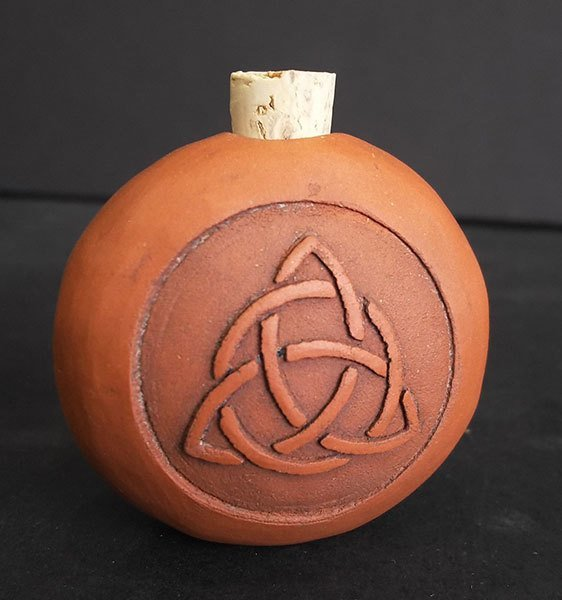 Terracotta bottle embossed with celtic knot
