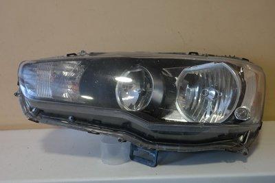 Фара левая Mitsubishi Lancer 10 Galogen