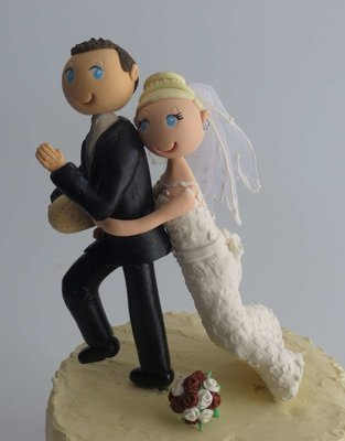 Bride Tackling Groom on round base board