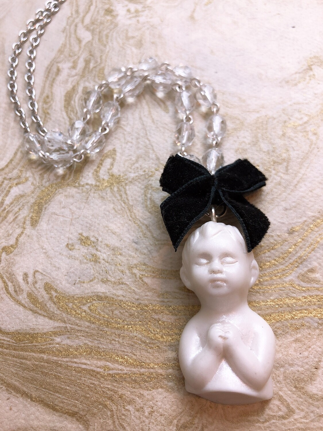 doll parts necklace (praying)