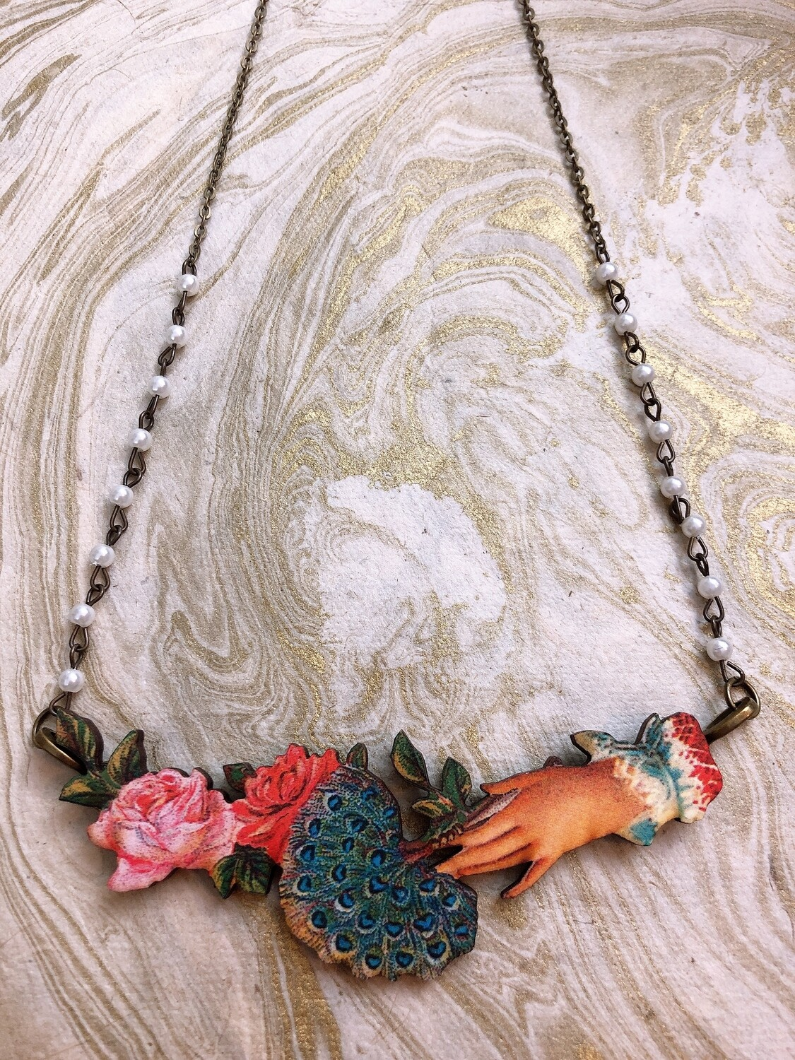 wood necklace (hand with roses and feathers)