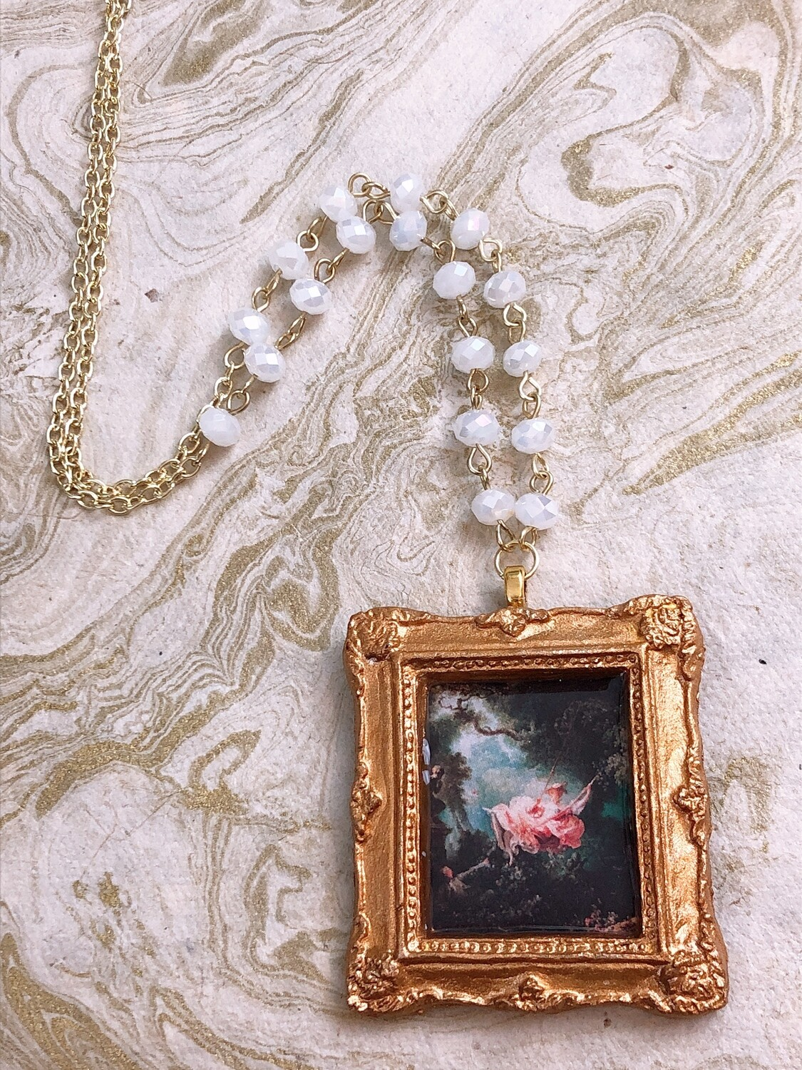 frame necklace (the swing)