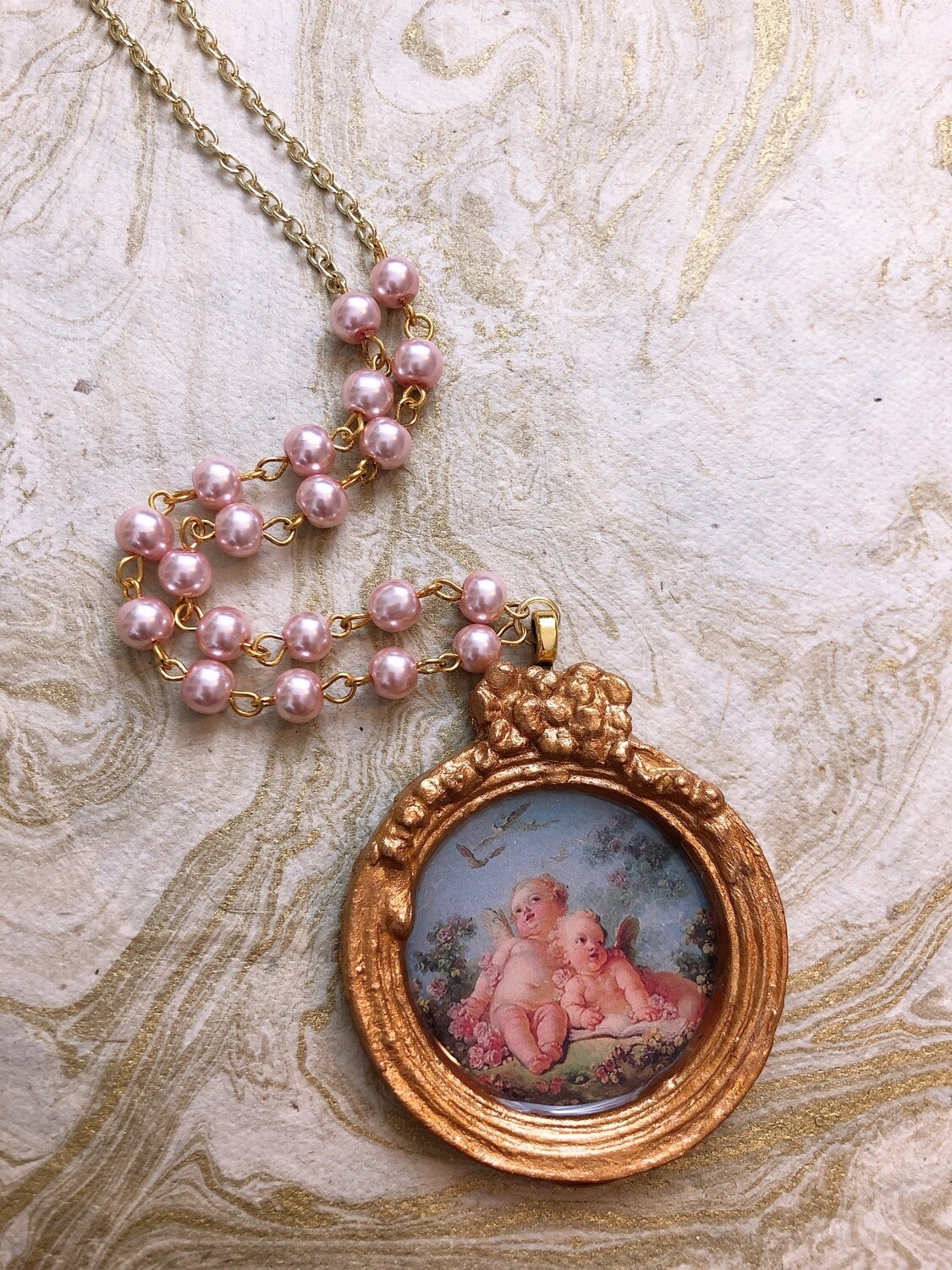 frame necklace (cherubs)
