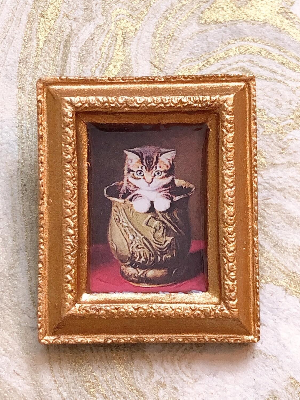 frame brooch (kitten in a vase)