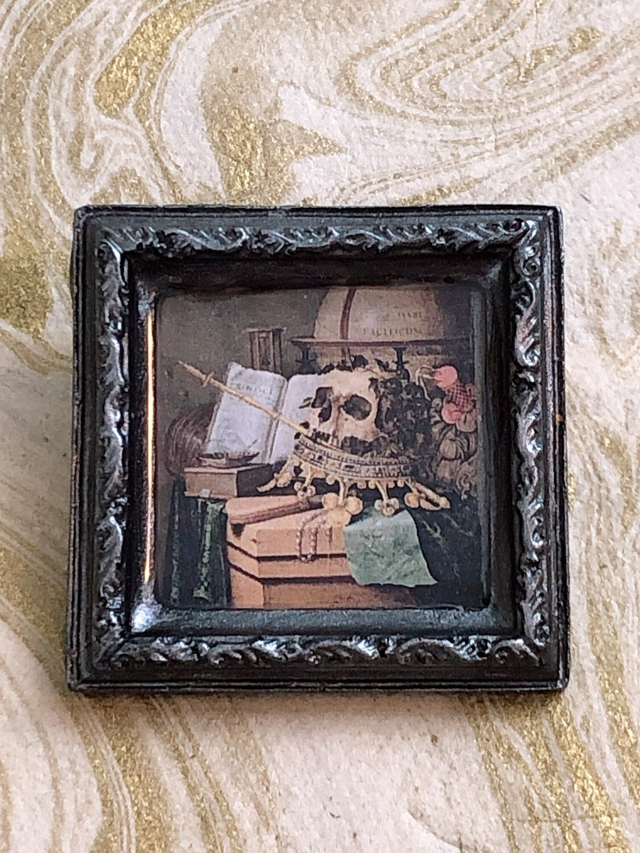 frame brooch (silver vanitas)