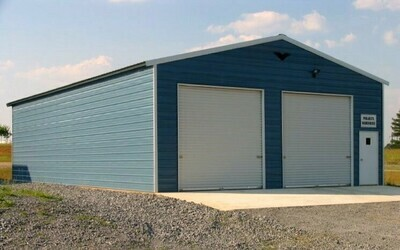 30 x 40 x 12 Work Shop with two 10 x 10 roll up doors and one walk in door.