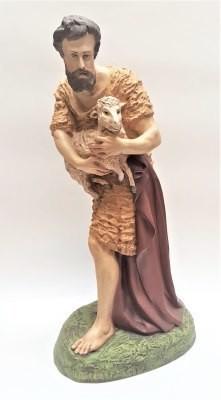 Herder staand met schaap