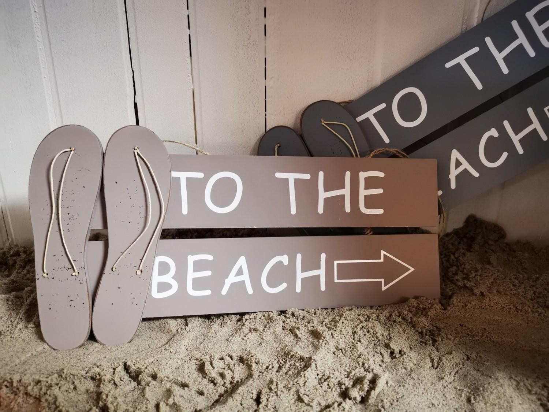 Tekstbord beach met flip-flop