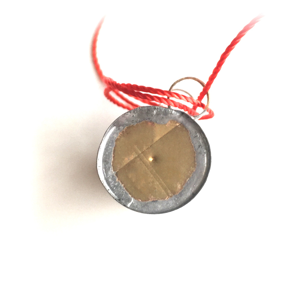 Sacred Metal Scroll with Red Magical Cord