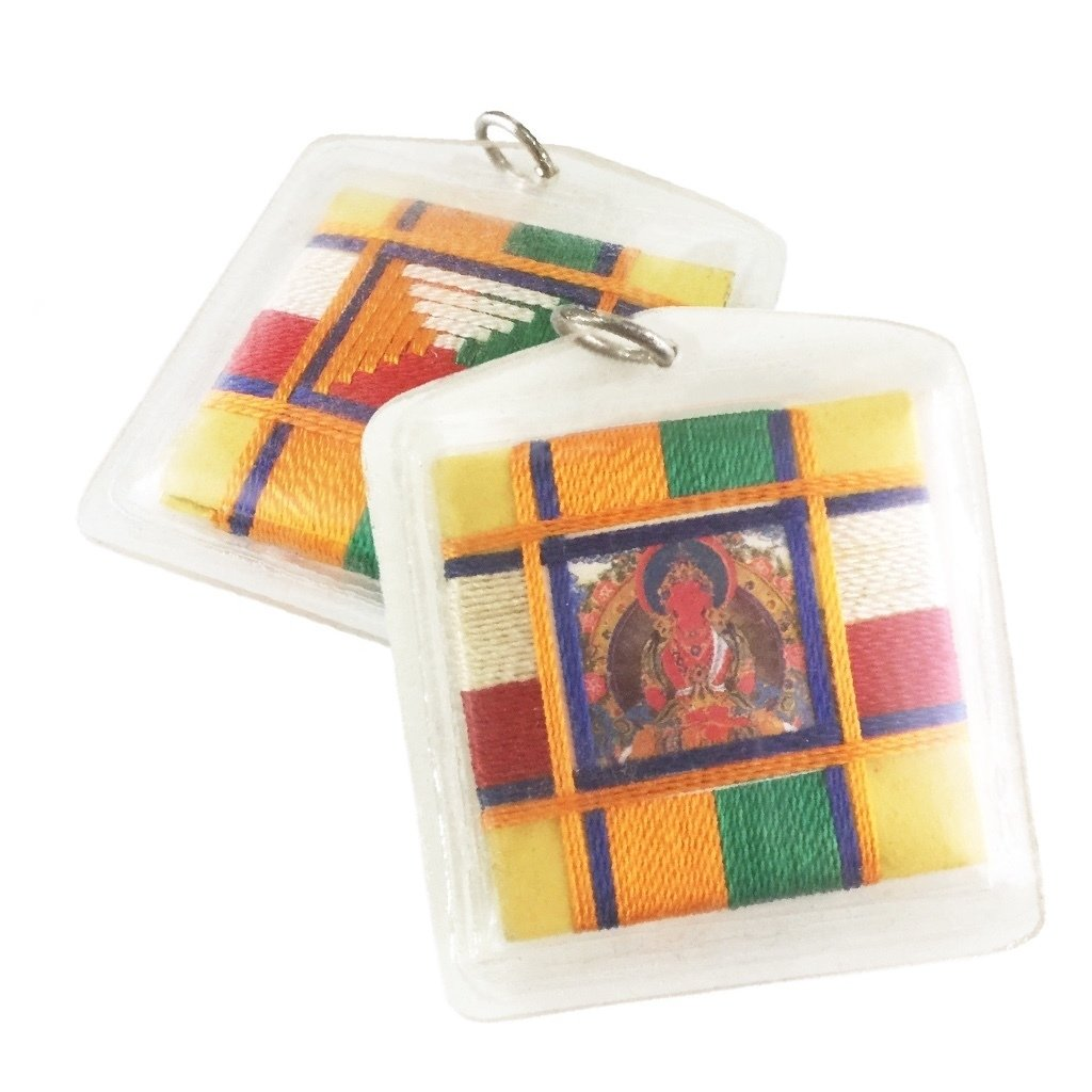 Sungkhor Locket of Amitayus Buddha of Immeasurable Life sitting in a Cosmic Mandala Diagram made from Sacred Thread