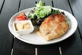 Air fried Chicken schnitzel , with vegetables