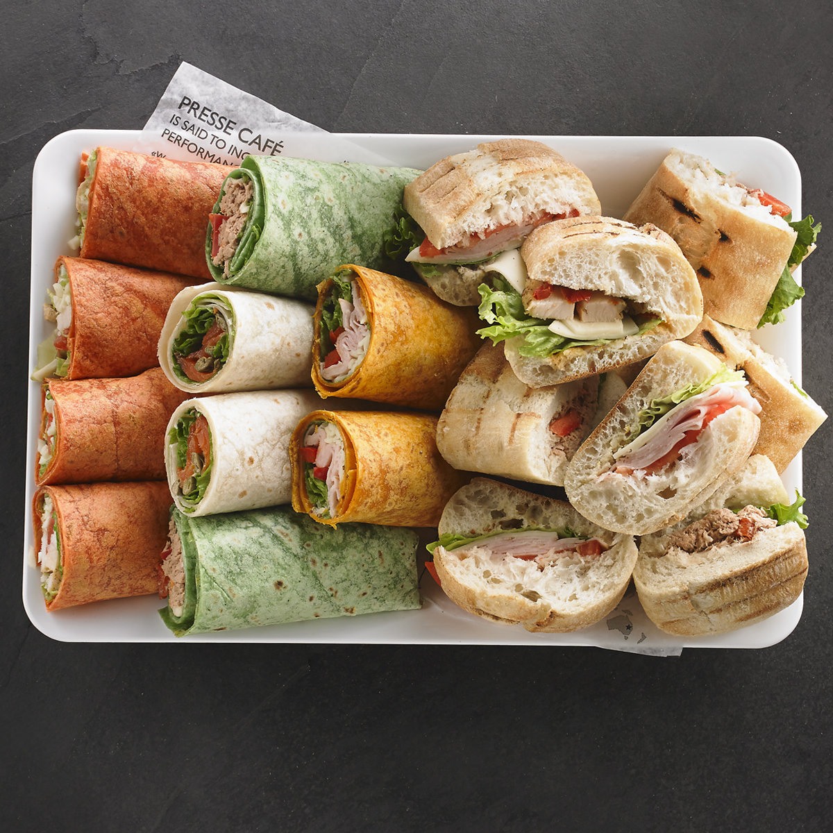 An assortment of Presswiches and wraps for 8 people / Price per person 6,95$