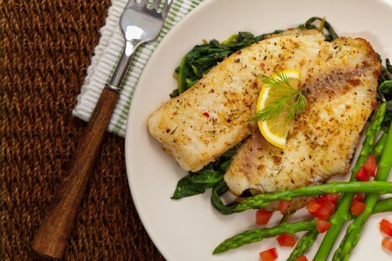 Fish Fillets Served with Short Grain Brown Rice.  Kale Salad