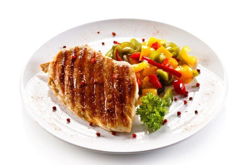 Roasted Chicken Breast Served with Quinoa and Vegetables. Brussel Sprouts Salad