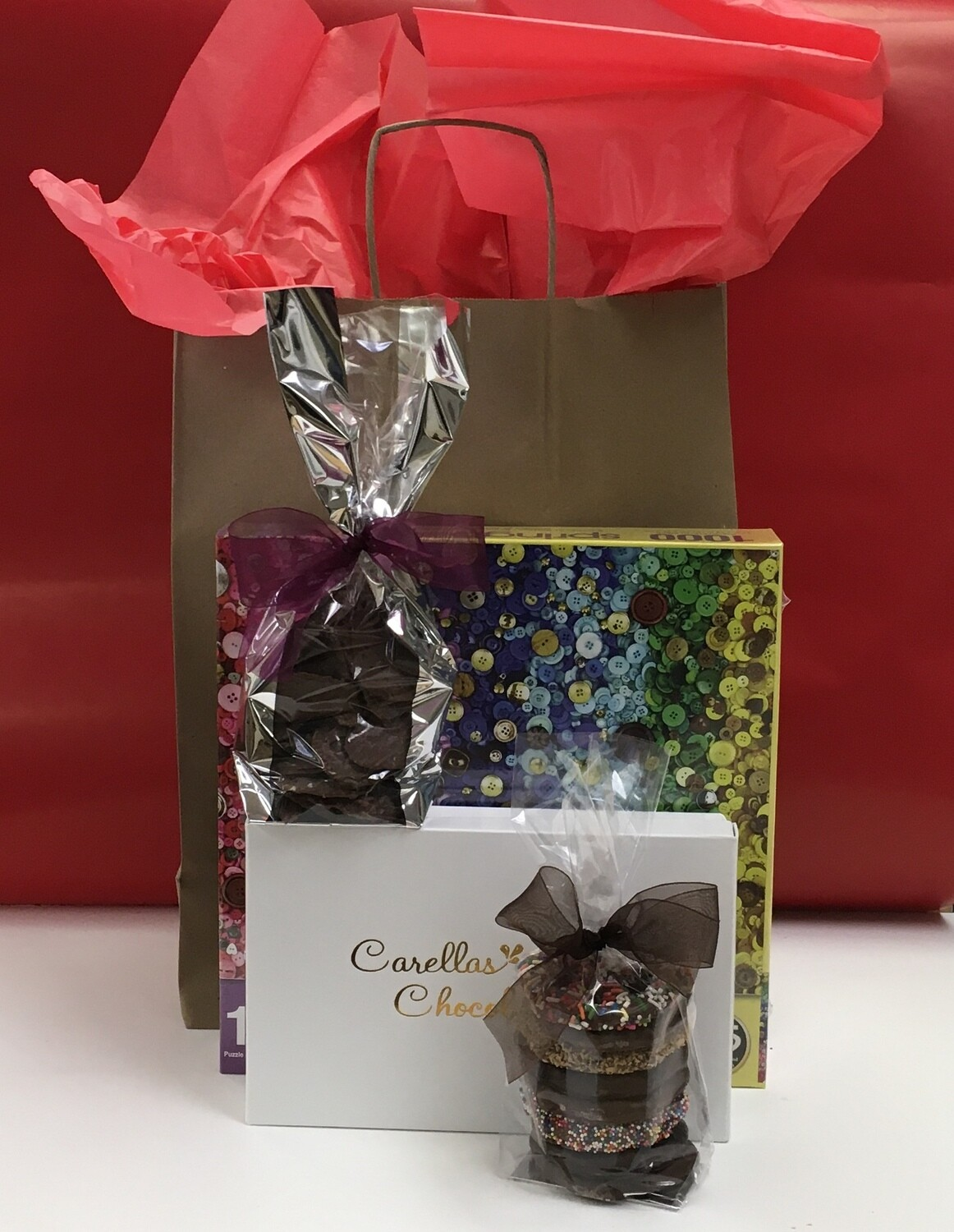 Drive up Package 1.  1000 piece puzzle, 2lb box of Assorted Chocolates, Choc Cov'd Potato Chips and 3 Ring Gourmet Pretzels.  Order and pick up at store or have it delivered! Puzzle design may vary.