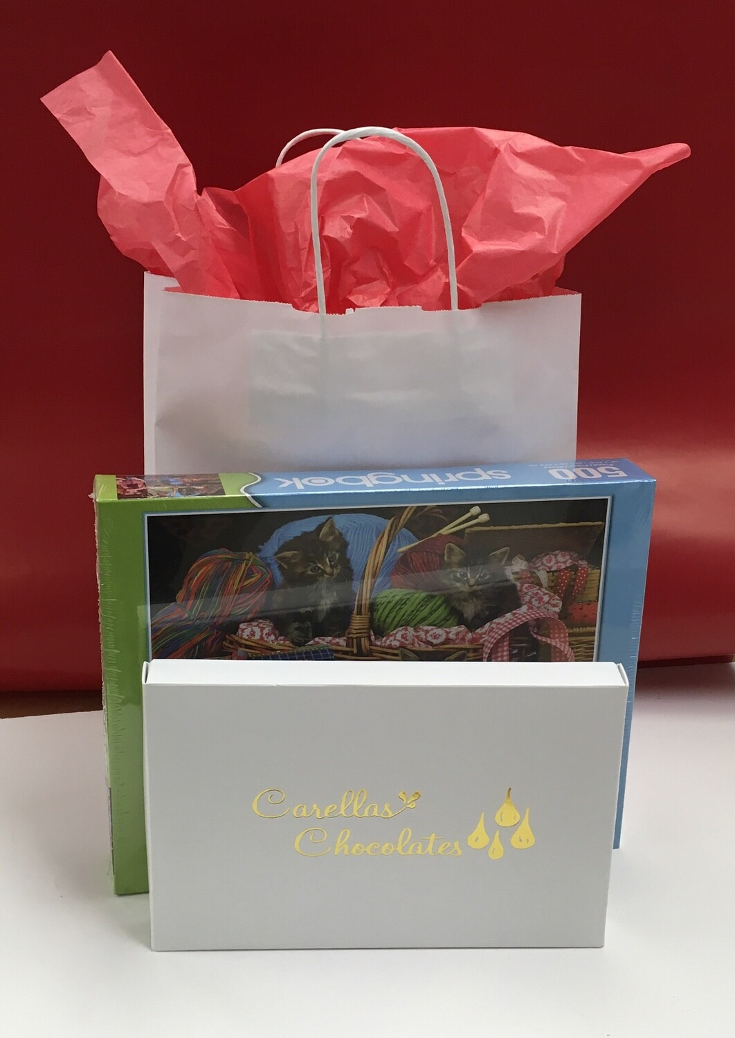 #3 Drive up Package.  500 Piece Puzzle and 1 Pound of Assorted Chocolates.  Puzzle scene may vary.