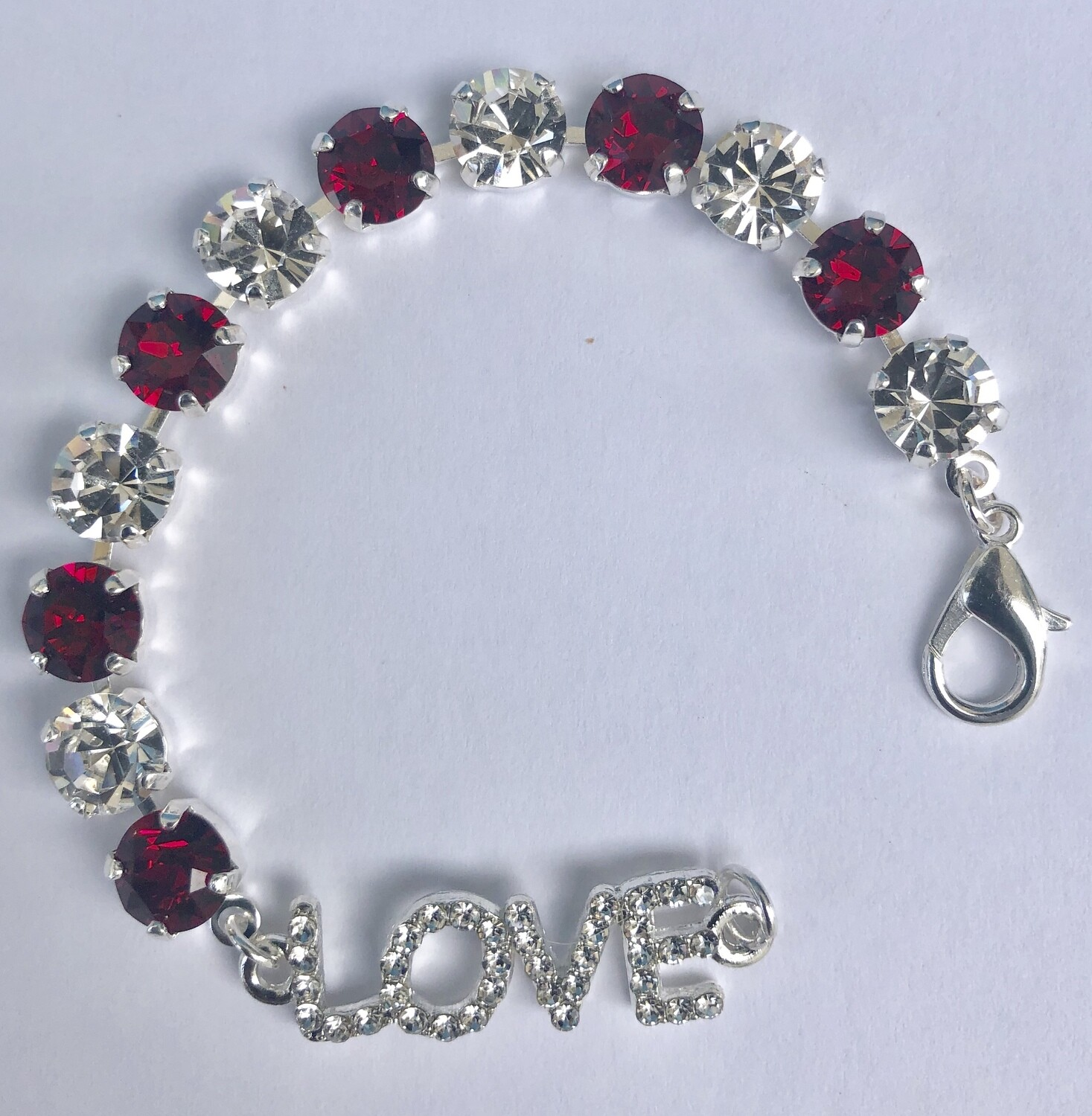 """Everlasting"" Love Bracelet consists of ruby red and clear crystals with a silver finish.  Handmade by Raine"