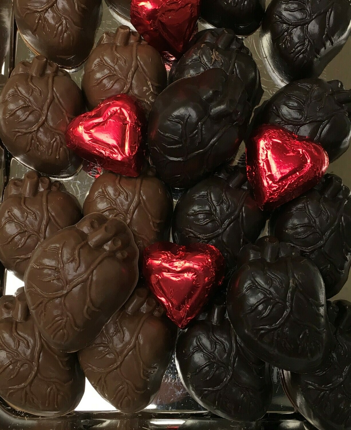 The Beating Heart. Priced by the Pound. Approx. 14 to a Poud. 1.5h x2Ll x1w.  (foiled hearts not included)
