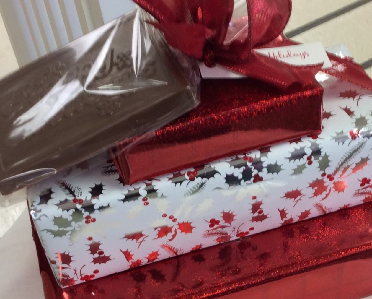 3 Tiered Chocolate Asst. Plus Holiday Greetings Milk Chocolate Bar. Boxed Assortments include 2 Lb. of Asst. Chocolates, 1.25 Lb. of Asst. 3 Ring Pretzels, 1/3 Lb. Mini Pretzels Assorted.