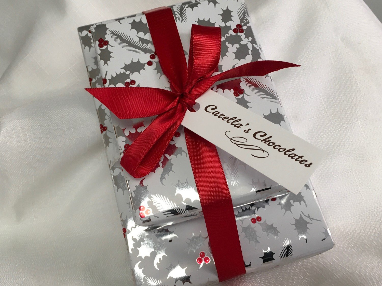 Three Tier Asst. Chocolates. 1 Lb. Assorted Chocolates, 1/2 Lb. Assorted 3 Ring Gourmet Pretzels and 1/2 Lb. Assorted Mini Pretzels. Wrapped w/Bow.