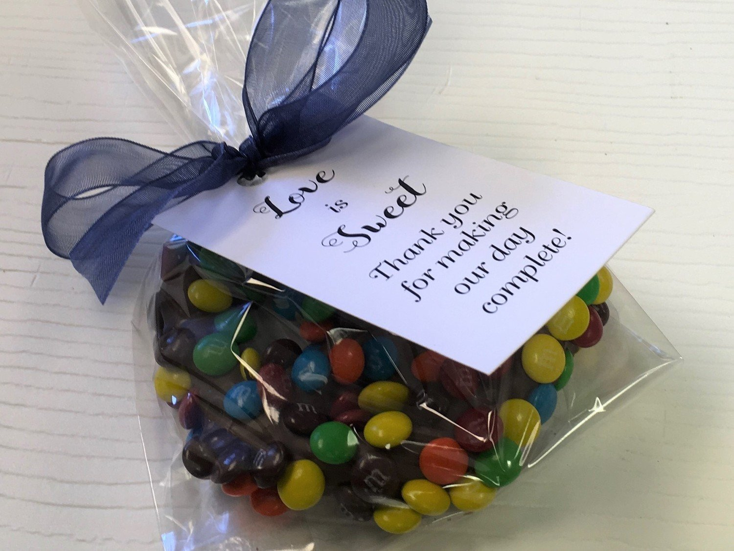 M&M 3 Ring  Gourmet Pretzel Favor.  Please chose ribbon color.  Tag is 112.50 extra per 25.  5 day pre orders over 50