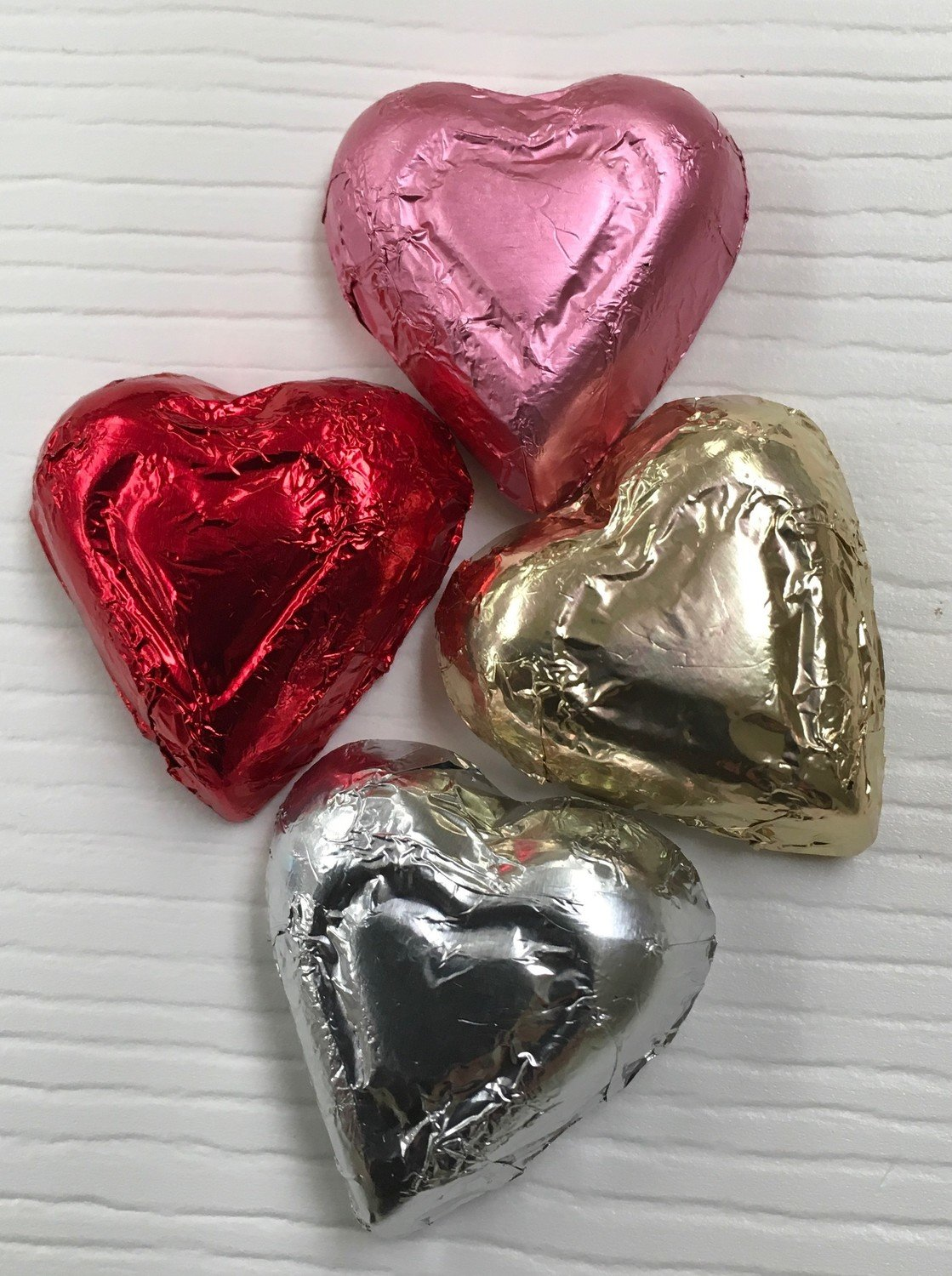Milk Chocolate Hearts.  Choose Colors.  (approx. 50 in pound) may contain traces of peanuts