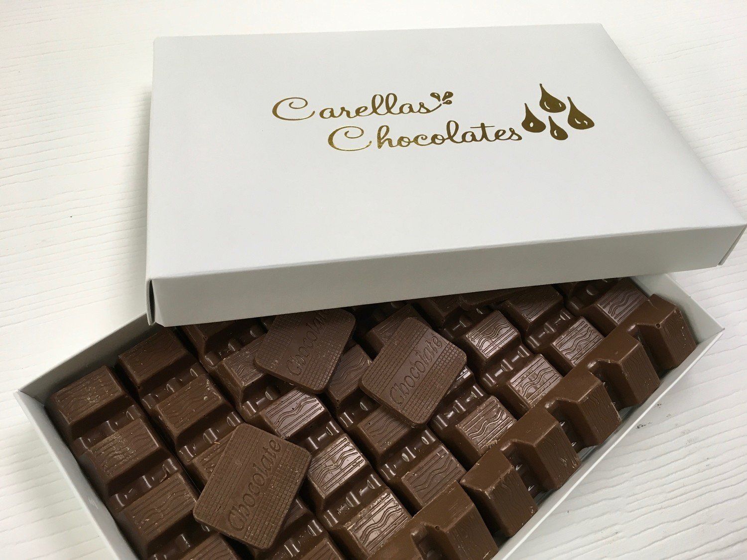 Carella's Chocolates Solid Chocolates Available Milk or Dark.  Peanut and Gluten Free.