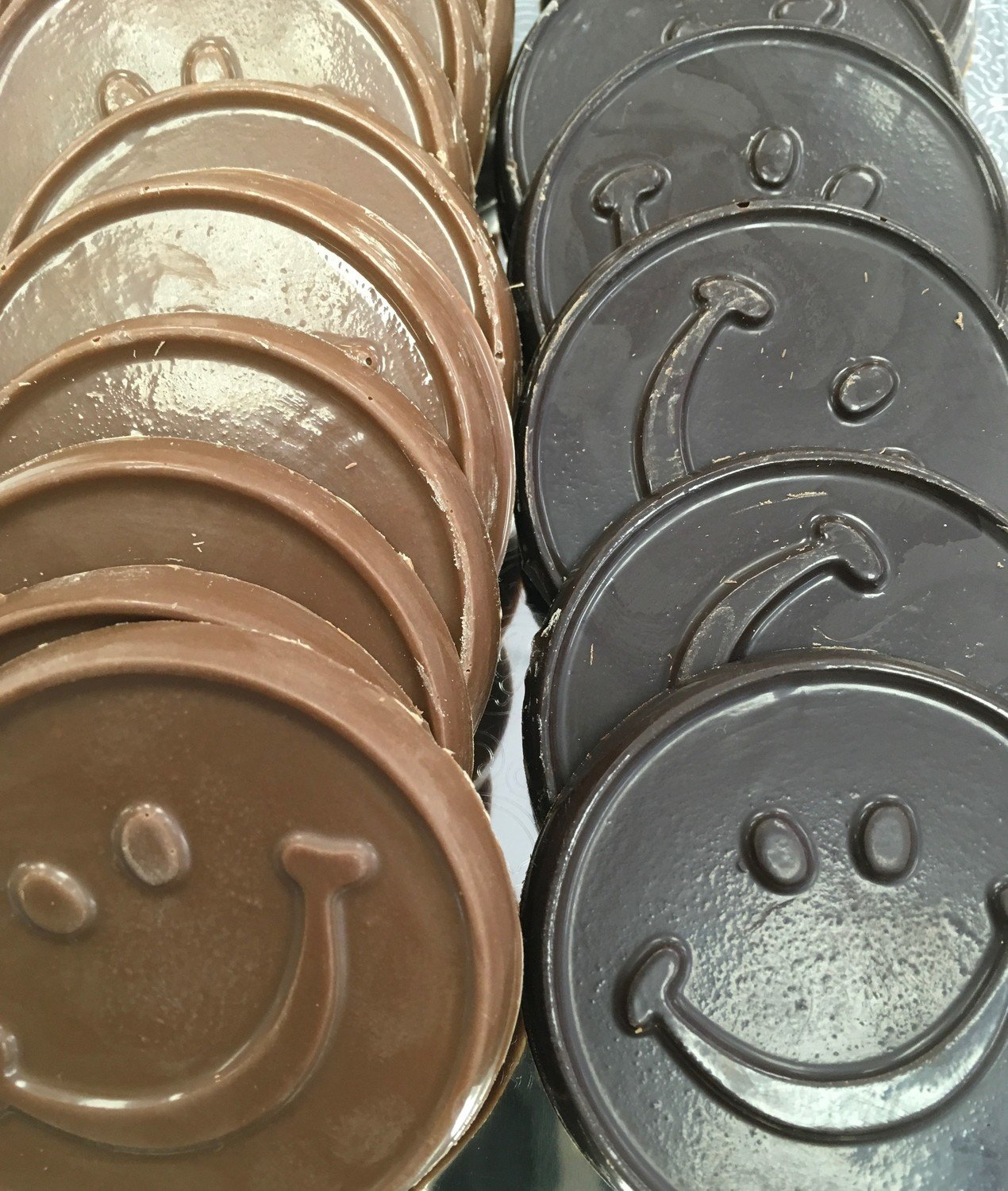 """Solid Chocolate Smiley Faces.  2 1/4"""" approx.  Peanut and Gluten Free.  20 to a Lb."""