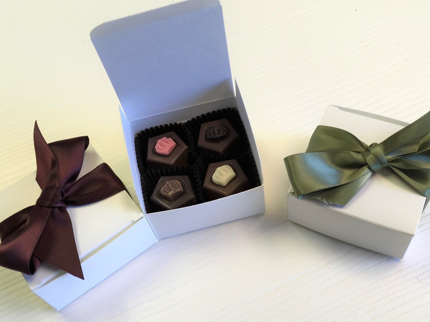 F - 25 - 4 Piece Favor Box, 2 Buttercremes, 2 Truffles (or 4 Truffles).  Choice of Ribbon Color.  10 day pre order.