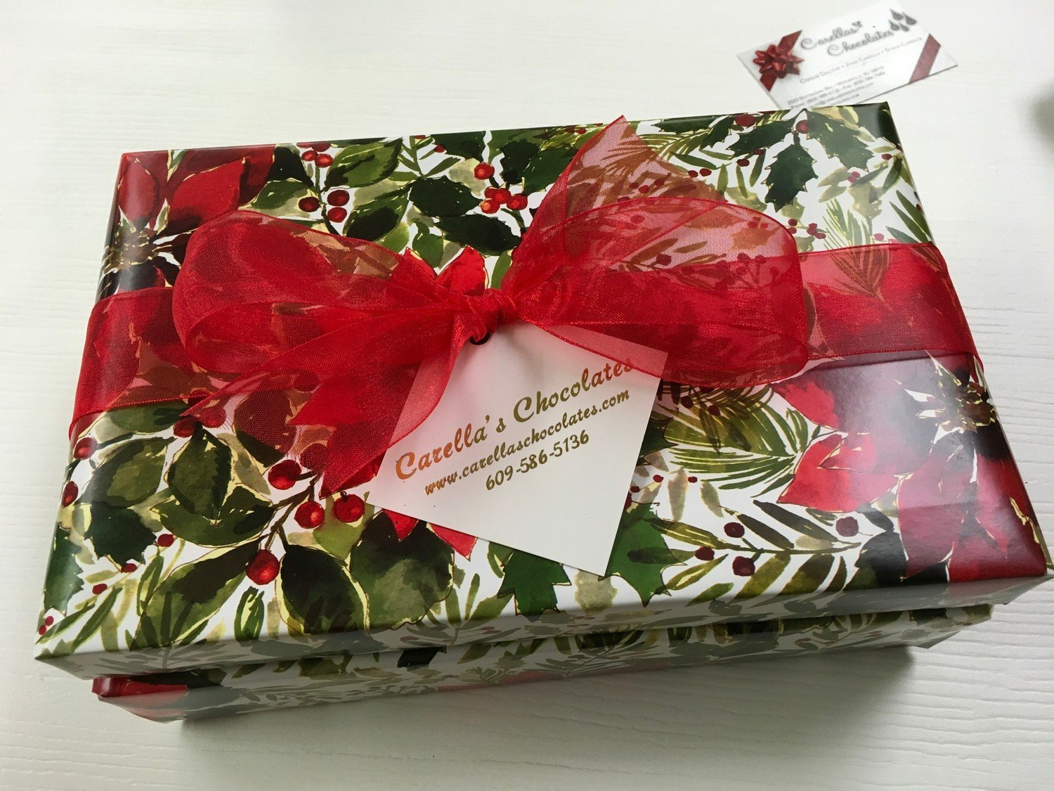 2 Tiered Holiday Chocolate Assortment wrapped and bowed.  1.1Lb. Assorted Chocolates Mk & Dk, 1.1Lb Assorted Truffles Mk & Dk