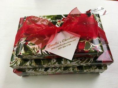3 Tiered Holiday Chocolate Assortment. 2Lb. box Assorted chocolates wrapped and bowed, 1 Lb. box Assorted Truffles, 1/3 Lb. Mini Pretzels Assorted Mk & Dk