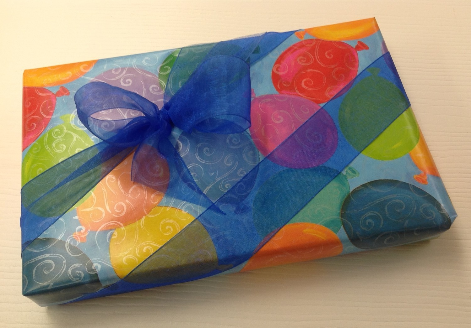 Happy Birthday Chocolate Assortments wrapped with bow.