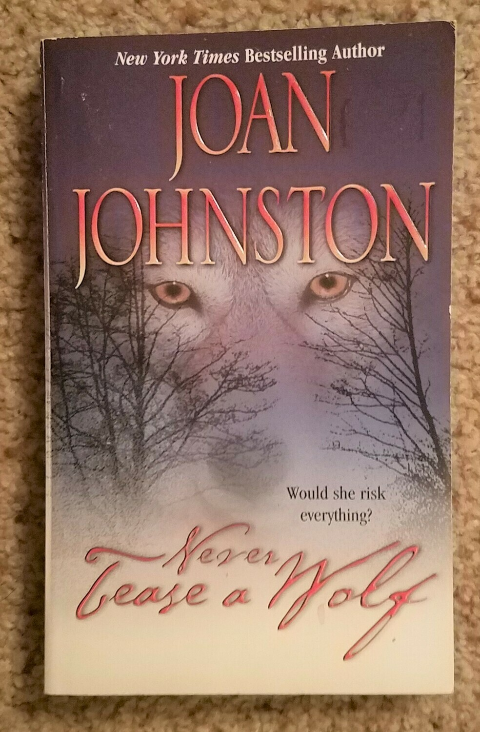 Never Tease a Wolf by Joan Johnston