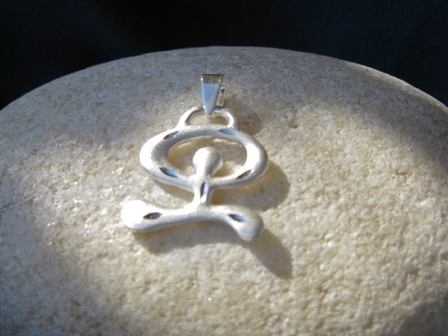 Indalo pendant ~ etched/reversible silver, dancing
