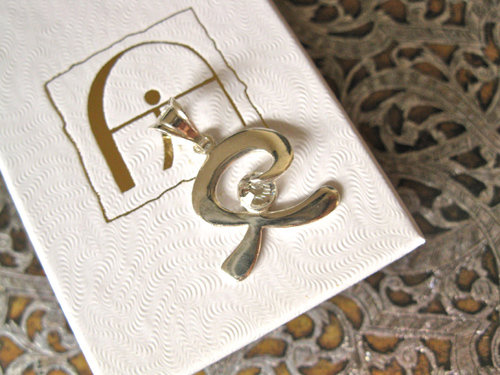 Indalo pendant ~  smooth, silver + zirconite