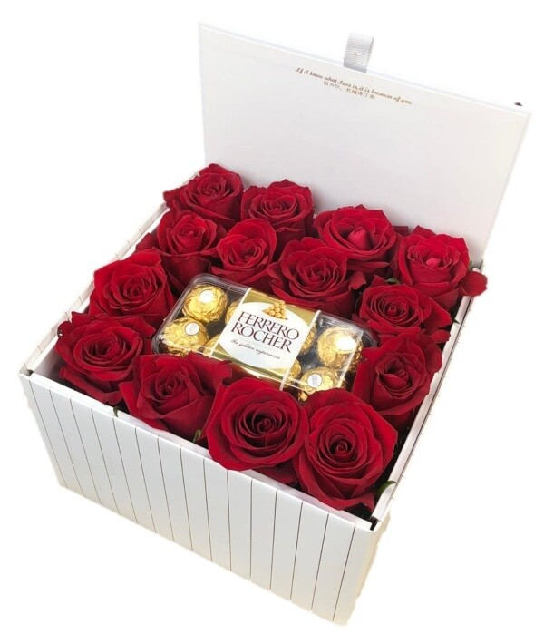 Large white box of roses with chocolate