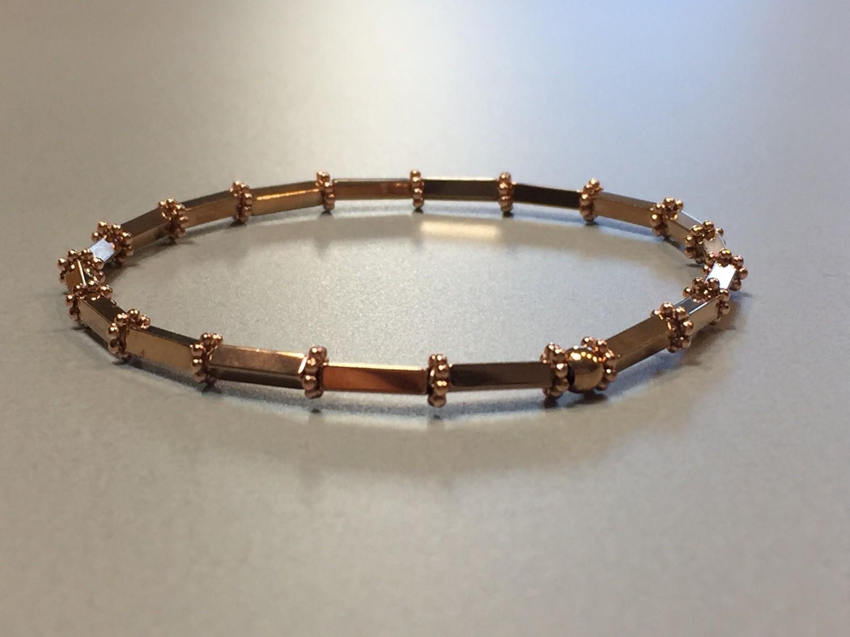 Elastisches Armband Hematit und Silbercharms rose vergoldet
