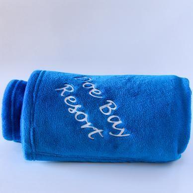 Blue Blanket with Doe Bay logo