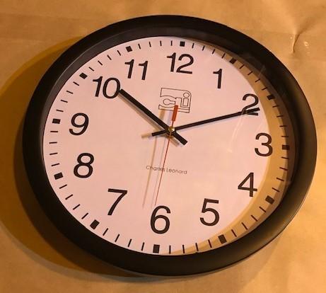 "Clock, Wall, Battery, 14"" face. Black quartz. Uses ""AA"" Battery"