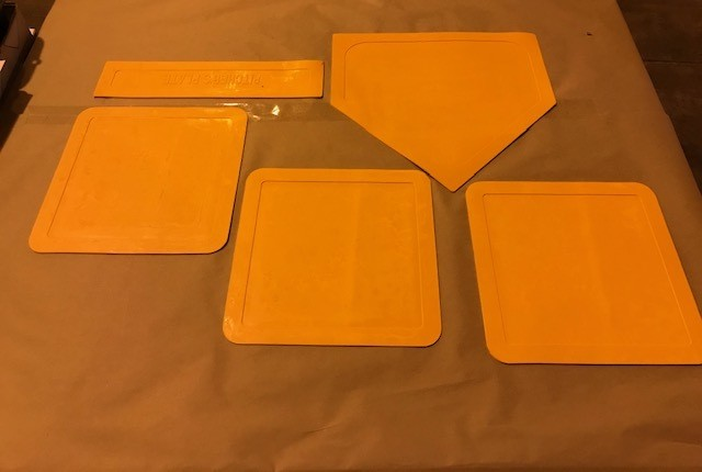 Bases, indoor/outdoor-thrown down: consists of home plate, three (3) bases, washable and flexible 10 per box