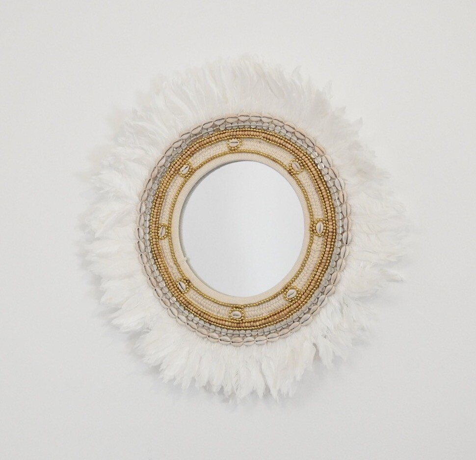 Luxe Juju Mirror with white feathers.