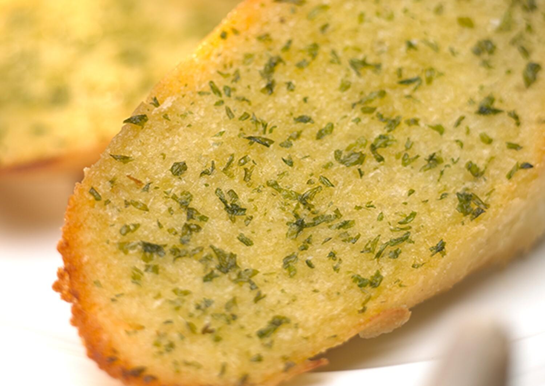 Hand spread Garlic Bread Slices