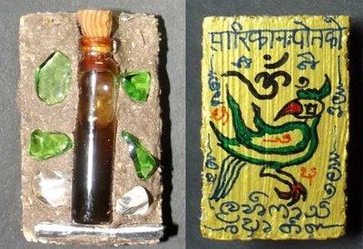 Sariga Liaw Hlang Jab Bpaag Loeng 'Ongk Kroo' (Golden Tongued Magpie on Coffin lid wood with Prai Oils, Silver Takrut, and Gemstones) - Pra Ajarn Taep Pongsawadarn