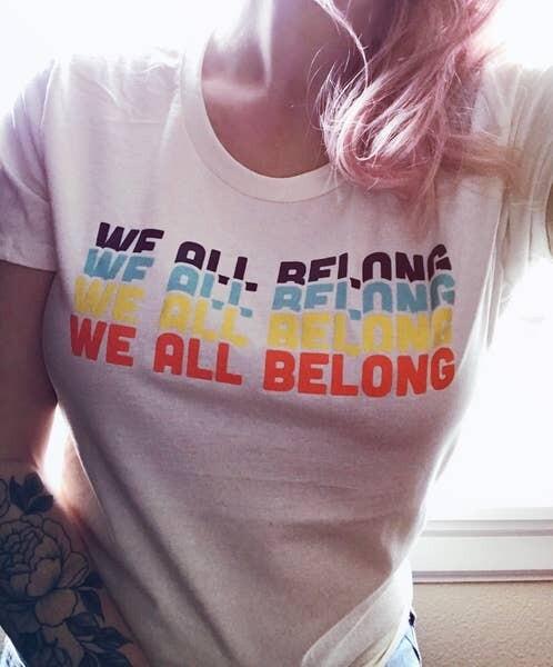 We All Belong Tee
