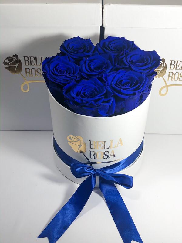 Caja redonda con 7 rosas naturales preservadas