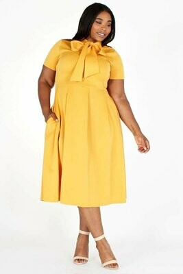 Solid, midi dress in a fit and flare style with a necktie, short sleeves, side pockets, and pleated skirt.