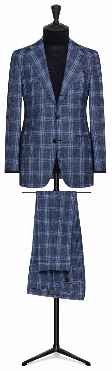 Blue Window Pane Plaid Check In Single Breasted Notch Lapel Roll To Two Button Suit Model w/ Lower Flap Pockets and Side vents
