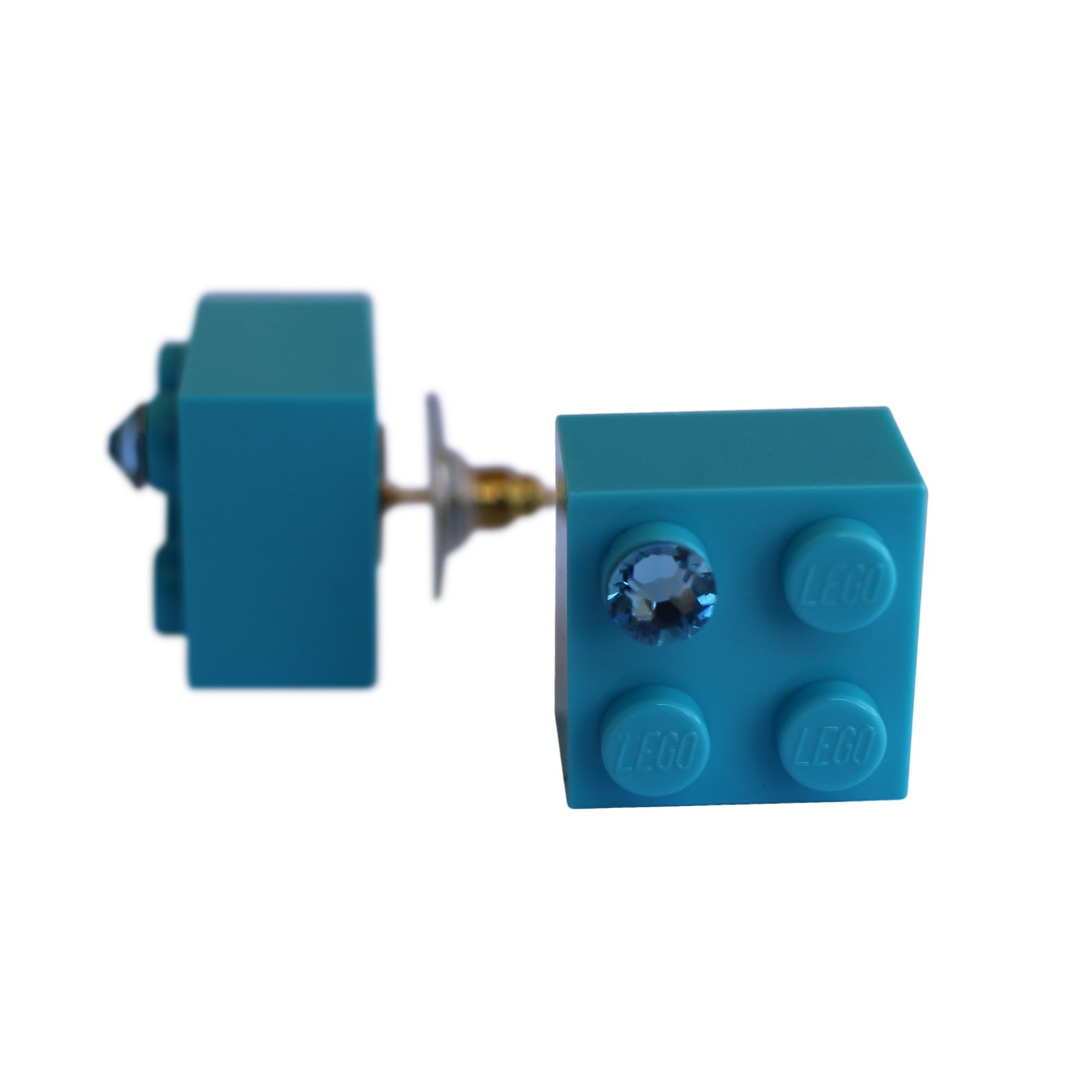 Turquoise Blue LEGO® brick 2x2 with a Blue SWAROVSKI® crystal on a Gold plated stud/silicone back stopper